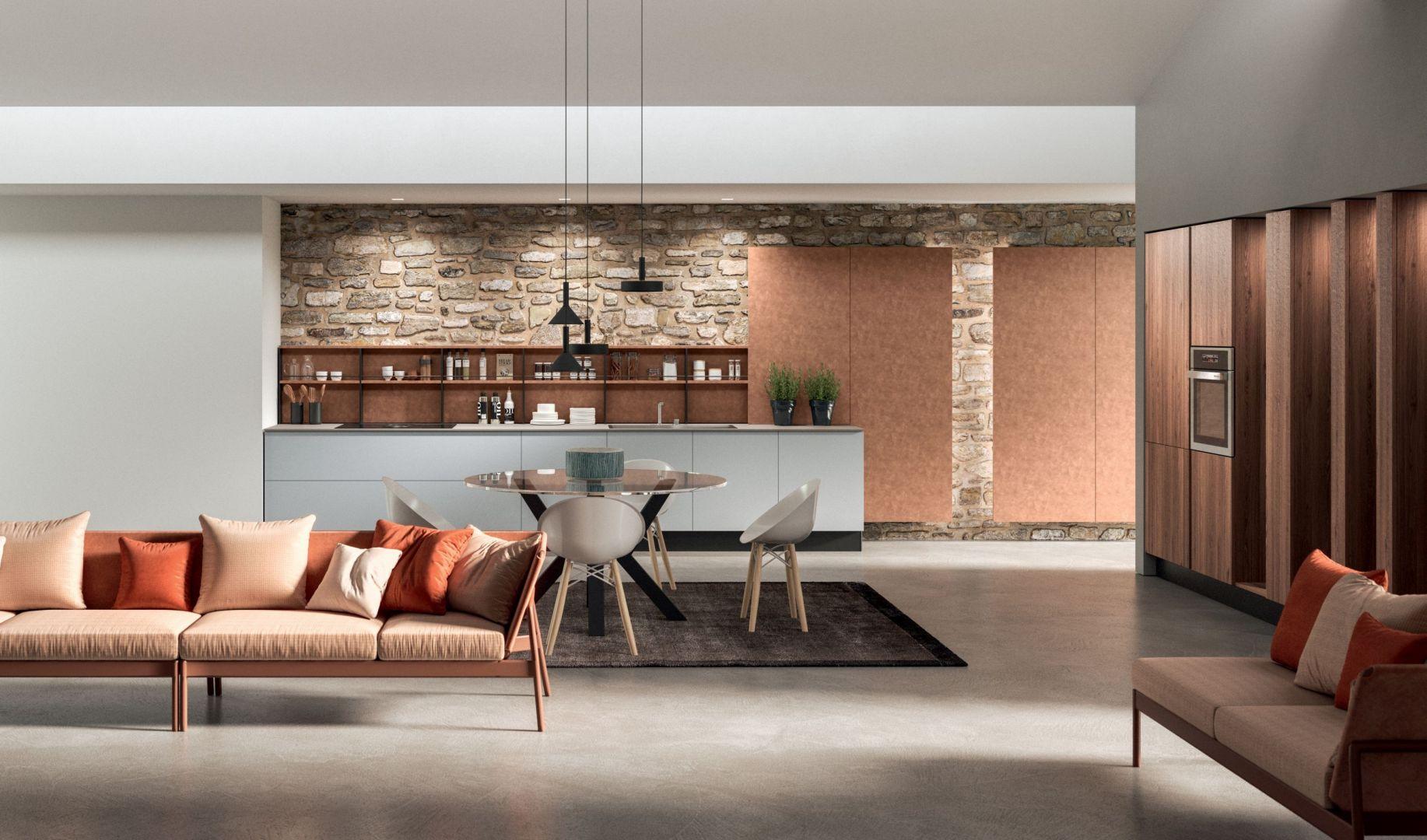 Na tle kuchni pięknie prezentuje się minimalistyczna w formie kolorowa sofa. Fot. ARAN Cucine Penelope