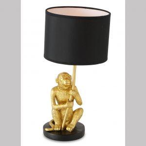 Nowoczesna lampka Monkey z małpką podtrzymującą stelaż. Dzięki użyciu bardzo plastycznego materiału figurka małpki została wykonana bardzo  starannie. Jest także odporna na utratę koloru i zniszczenia. Cena: 139 zł. Do kupienia w sklepie dekoracjadomu.pl. Fot. dekoracjadomu.pl