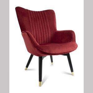 Fotel Glam Wine marki HowHomely. Obicie, z którego wykonano fotel, jest miłe w dotyku, a jednocześnie odporne na zabrudzenia. Materiał wykorzystany przy produkcji to wytrzymały poliester, który zapewni wiele lat użytkowania. Konstrukcja fotela, w tym także nogi wykonane zostały z naturalnego drewna kauczukowego lakierowanego na czarno. Cena: 899 zł. Do kupienia w sklepie dekoracjadomu.pl. Fot. dekoracjadomu.pl