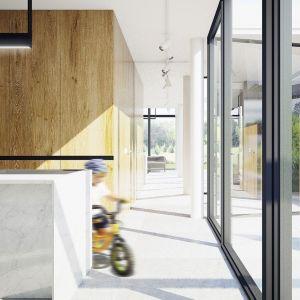 Aluminiowe przeszklenia, biel i drewno. Projekt wnętrza: Adam Zwierzyński i Anna Porębska z pracowni MUS Architects
