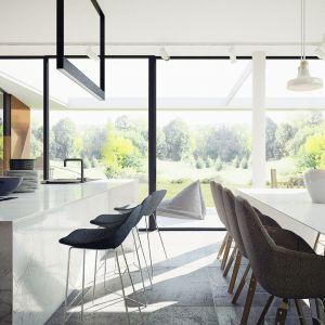 Nowoczesna wyspa kuchenna i biały stół w jadalni. Projekt wnętrza: Adam Zwierzyński i Anna Porębska z pracowni MUS Architects