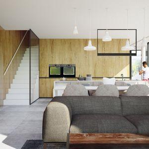 Otwarta część dzienna z pięknie wyeksponowanym drewnem. Projekt wnętrza: Adam Zwierzyński i Anna Porębska z pracowni MUS Architects