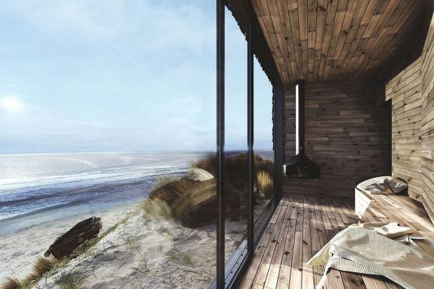 Dom przy plaży to niewielki dom wypoczynkowy, który miał być wpisany w naturalny nadmorski krajobraz. Jak wam się podoba ten pomysł? To projekt Anny Adamowicz, Filipa Gołaszai Damiana Machnika zZakładu Usług Projektowo-Architektonicznych ZUP-