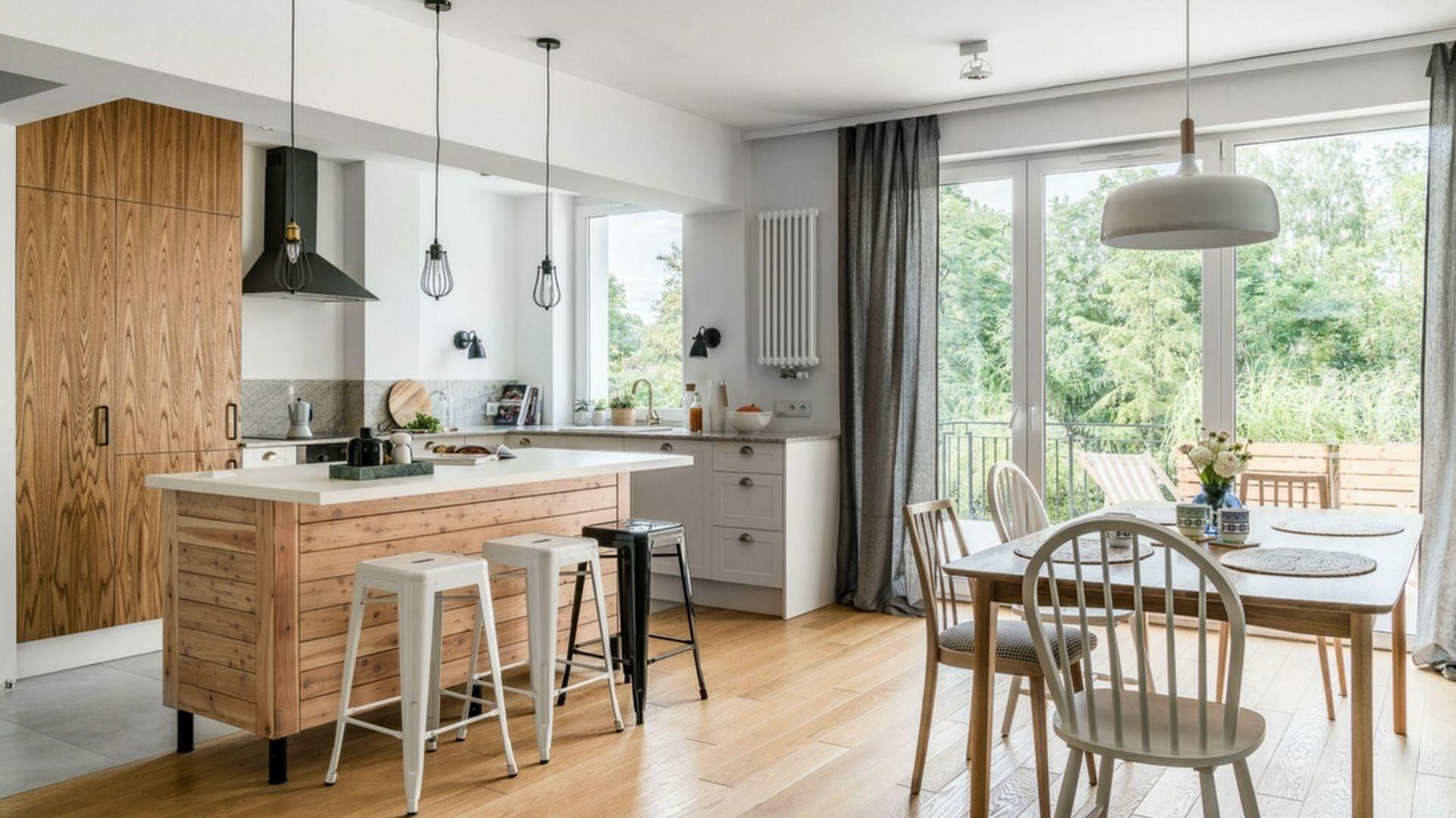 Drewniana kuchnia świetnie wygląda na tle neutralnej bieli. Projekt Magdalena Dąbrówka, Kształt Rzeczy. Zdjęcia Fotomohito