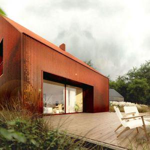 Kompaktowy budynek oferuje funkcjonalną przestrzeń do życia ze strefą dzienną w parterze oraz sypialniami na poddaszu. Projekt: Domy z Głową, Pracownia Architektury Głowacki