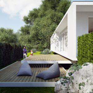 Z tarasu roztacza się widok na las. Dom Pod Lasem. Projekt: Anna Porębska, Adam Zwierzyński, MUS Architects