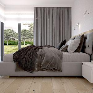 Na ścianie za łóżkiem znalazła sie geometryczna stonowana tapeta oraz drewniane lamele w odcieniu naturalnego drewna. Projekt Katarzyna Czechowicz, Design Me Too