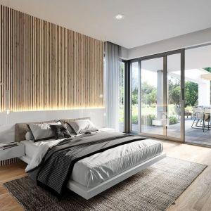 Z przestronnej sypialni mamy bezpośrednie wyjście na taras. Nazwa projektu: Hiacynt. Projekt wykonano w Pracowni MG Projekt