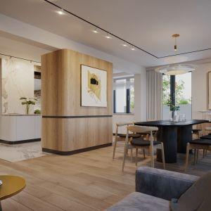Zaokrąglone krawędzie mebli nawiązują do stylu art deco. Projekt wnętrz: JMW Architekci