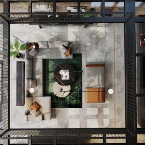 Surowe materiały jak metal czy szkło połączono tu z drewnem i kamieniem. Projekt wnętrz: JMW Architekci