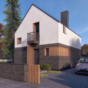 Budynek z dwuspadowym dachem o stonowanej estetyce może harmonijnie współgrać zarówno z otoczeniem miejskim, jak i naturalnym. Autor projektu arch. Tomasz Sobieszuk, pracownia DOMYwStylu.pl