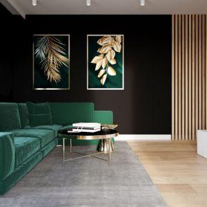W salonie ustawiono wygodny narożniki wykończony aksamitem w kolorze butelkowej zieleni. Jest on mocnym akcentem, nadającym przestrzeni indywidualnego charakteru Projekt i zdjęcia: Karolina Słomińska, D' INTERIOR Studio Wnętrz