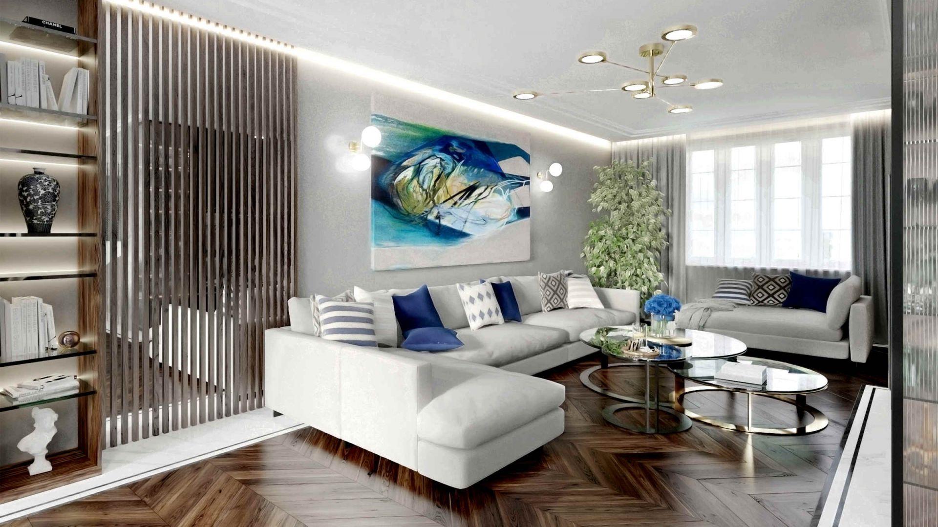 Elegancki salon ożywiają złoto i różne odcienie koloru niebieskiego. Projekt Tissu Architecture