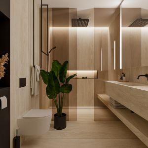 Elegancki ciepły beż króluje w tej łazience w bloku. Projekt Naboo Studio