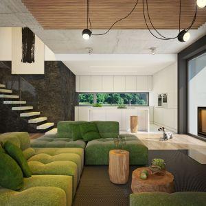 Otwarta strefa dzienna: w oddali widoczna jest biała kuchnia. Nazwa projektu: Dom modny III. Projekt wykonano w Pracowni Doomo