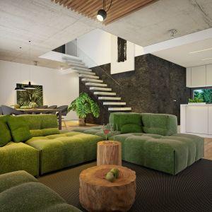 Wnętrza domu charakteryzuje duża przestronność. Widać to w otwartej przestrzeni, łączącej pomieszczenia części dziennej z holem piętra. Nazwa projektu: Dom modny III. Projekt wykonano w Pracowni Doomo