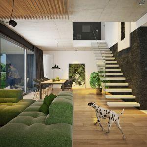 Proste schody i szklana balustrada doskonale pasują do nowoczesnej strefy dziennej. Nazwa projektu: Dom modny III. Projekt wykonano w Pracowni Doomo