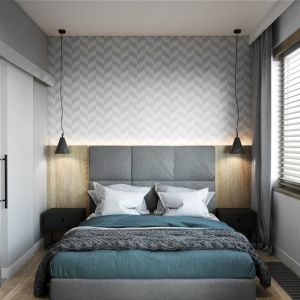 Proste, czarne lamy doskonale wpisują się w nowoczesną stylistkę sypialni. Na ścianie za łóżkiem zamontowano także oświetlenie ledowe. Projekt Justyna Krupka, studio projektowe Przestrzenie