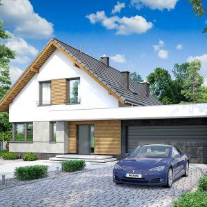 Prosta, foremna bryła sprawiają, że dom świetnie wpisze się w każde otocznie. Nazwa projektu: Pomelo. Projekt wykonano w Pracowni Archand