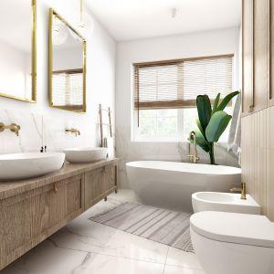 W łazience, znajdującej się przy sypialni, znajdziemy marmurowy spiek o beżowym odcieniu oraz złote dodatki. Projekt: Marta Ogrodowczyk, Marta Piórkowska. Wizualizacja: Elżbieta Paćkowska