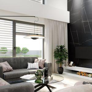 Wnętrze ma jasny i czytelny podział na strefy. Na parterze mamy komfortową część dzienną, a na piętrze funkcjonalną strefę wypoczynkową. Nazwa projektu: HomeKONCEPT 64. Projekt wykonano w Pracowni HomeKONCEPT