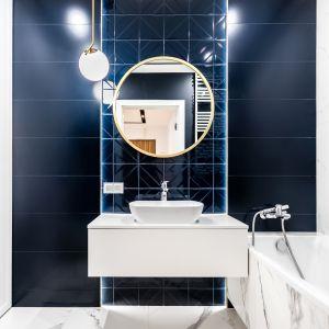 Zaprojektowanie mieszkania w standardzie premium wiąże się z wyeksponowaniem najważniejszych elementów oraz wykorzystaniem wyselekcjonowanych dodatków. Fot. Mieszkanie Wola MOOVIN