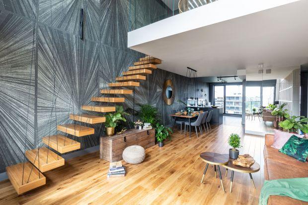 Apartament na warszawskim Żoliborzu to spokojna przestrzeń pełna botanicznych inspiracji. Mnóstwo tu odniesień do świata przyrody, podanych w nowoczesnym, eleganckim stylu.