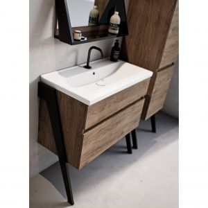 Meble ze wzorem drewna idealnie ocieplą chłodne tony kolorystyczne występujące w łazience. Na zdjęciu: meble z kolekcji Op-Arty. Fot. Defra