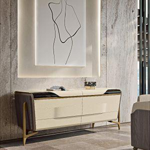 Detale ze szczotkowanego złota stają się wspólnym wątkiem elementów salonu, jadalni i sypialni. Fot. Turri Meltinglight dining room