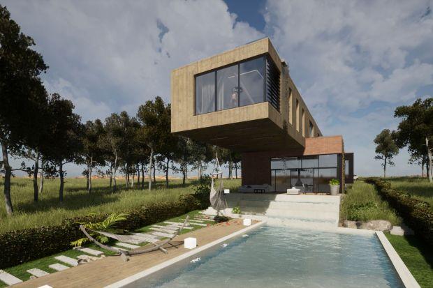 Projekt tego domu jednorodzinnego charakteryzuje się nietypowym nadwieszeniem, które rozciąga się w stronę podłużnego ogrodu, zadaszając przy tym taras oraz strefę z basenem. Zobaczcie nietypowy projekt architektów z pracowni Studio BB Architekc