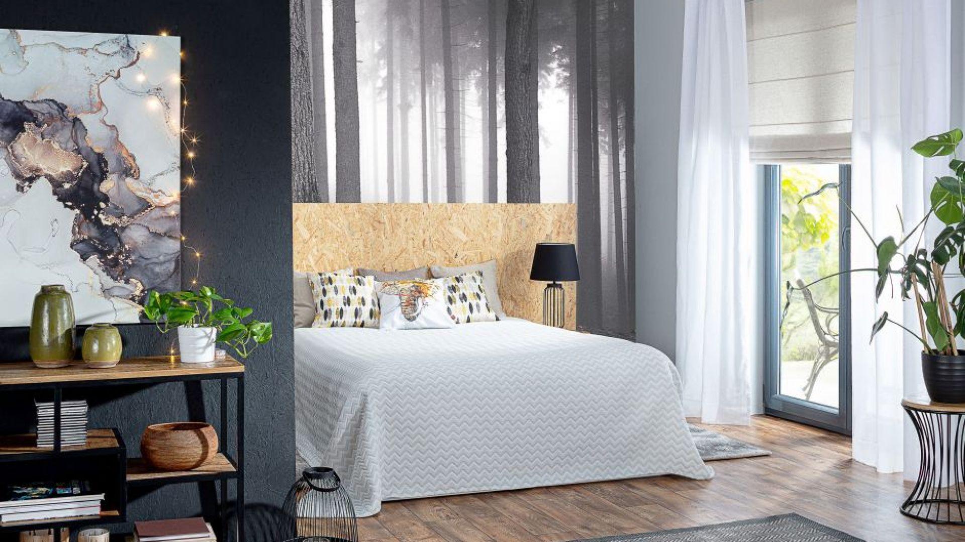 W sypialni sprawdzą się roślinne wzory i obrazy w stonowanych kolorach. Na zdjęciu obraz na płótnie Black & Gold Abstraction. Fot. Dekoria