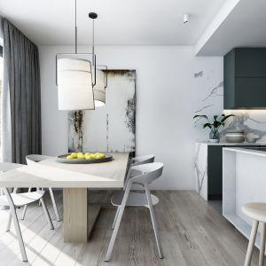 Strefa dzienna apartamentu okazała się na tyle przestronna, że w bezpośrednim sąsiedztwie kuchni znalazło się miejsce na pełnowymiarowy stół. AM.Home_projekt wnętrza_Elegancki minimalizm_4.jpg