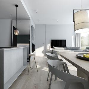 By uzyskać jak najwięcej światła i przestrzeni, strefa dzienna wnętrza została maksymalnie otwarta poprzez usunięcie części ścianki działowej w korytarzu. Projekt AM.Home
