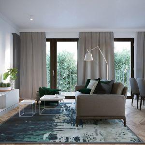 Wygodna sofa oddziela jadalnię od części wypoczynkowej. Projekt JMW Architekci