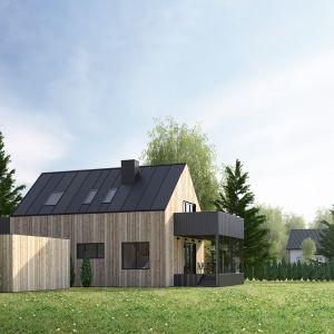 Nowa bryła domu w Sandefjord wyłożona została pionowymi deskami sosnowymi oraz grafitową blachą trapezową. Autorzy projektu: Paweł Lipiński, Fryderyk Graniczny, Mateusz Frankowski
