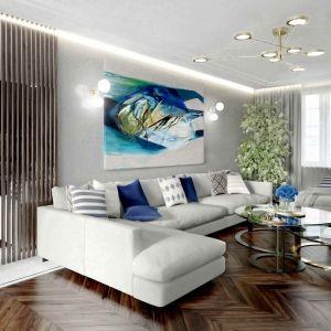 Na jasnoszarej ścianie znalazł się obraz w niebieskich odcieniach. To dobry pomysł na dodanie charakteru jasnemu wnętrzu. Projekt Magdalena Kostrzewa-Świątek i Agnieszka Zaremba, Tissu Architecture