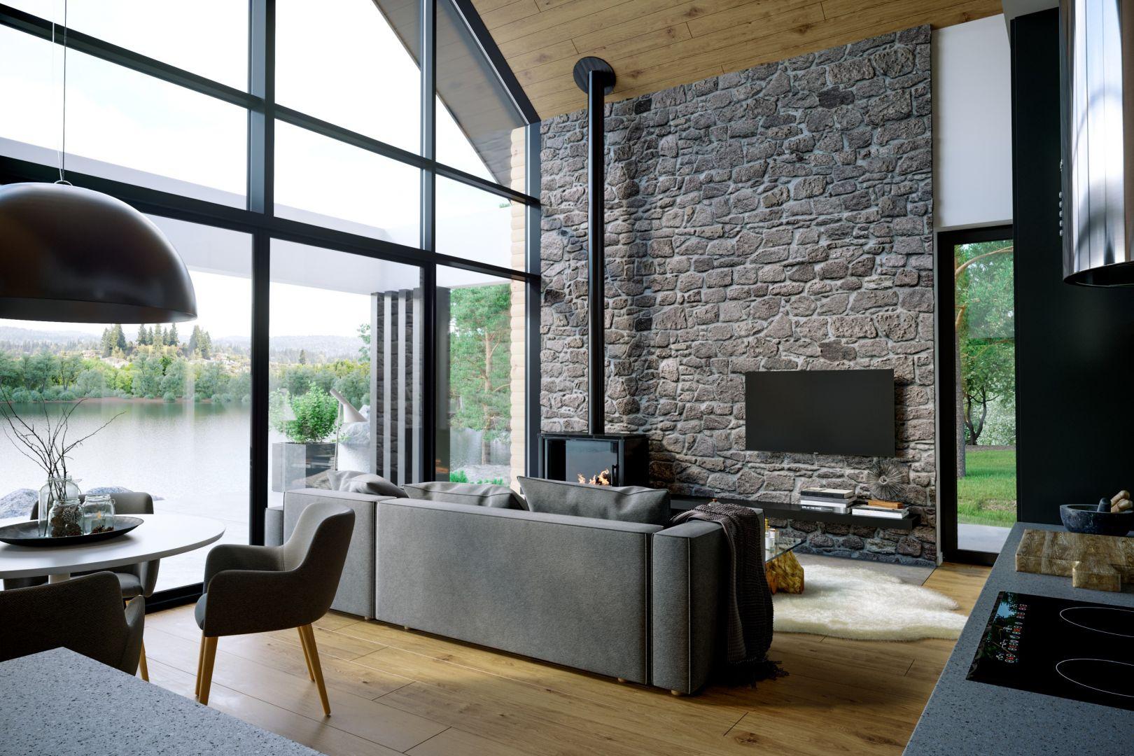 """Zarówno wystrój wnętrza, jak i okna w projekcie """"stodoły"""" powinny współgrać, a nawet podkreślać charakter tego rodzaju budynku. Tu rządzi prostota formy, funkcjonalność i natura. Fot. OknoPlus HomeKONCEPT"""