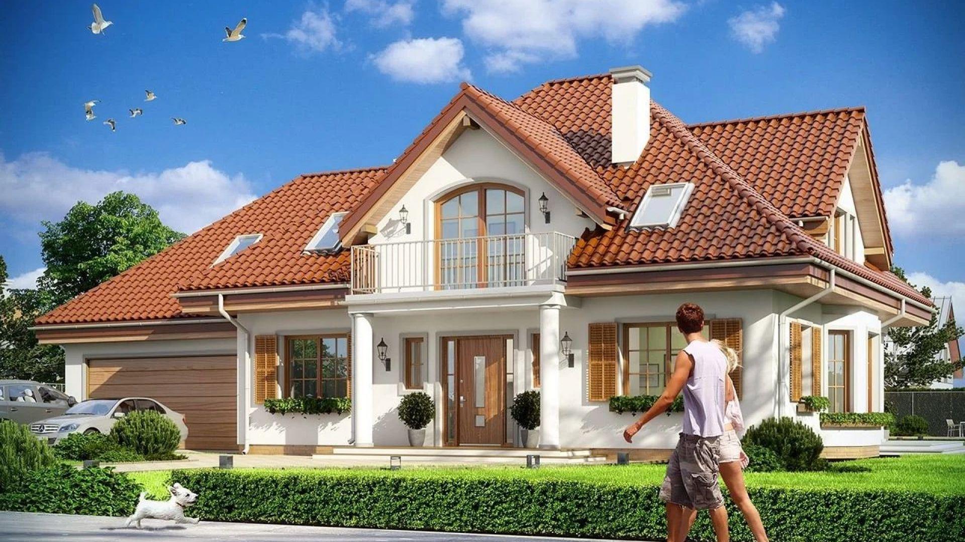 Projekt domu Ofelia ma ładną, reprezentacyjną bryłę z frontowym gankiem i dużą lukarną z balkonem nad drzwiami. Projekt: arch. Michał Gąsiorowski. Fot. MG Projekt