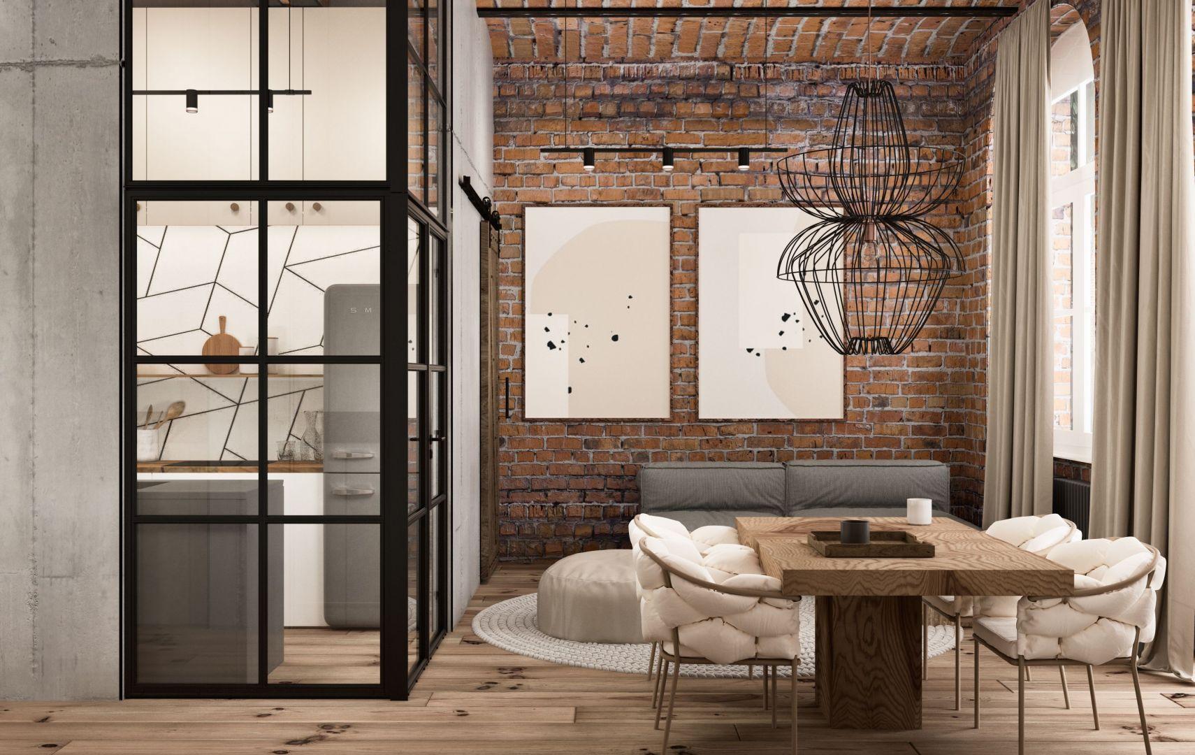 Wyłożona cegłą ściana nadaje wnętrzu unikatowy, loftowy klimat. Projekt Nowa Papiernia