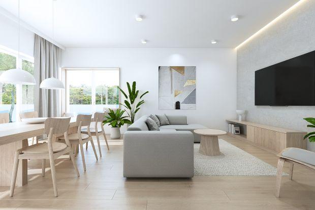 Wnętrza domu w Tarnowie Podgórnym to projekt Sebastiana Maracha z pracowni Yono Architecture.Otwarte przestrzenie wypełniono bielą, betonem architektonicznym, drewnem i szarościami.
