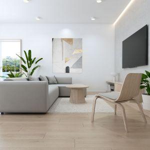 W części dziennej króluje biel, jasne drewno i szarości. Projekt: Sebastian Marach, pracownia Yono Architecture