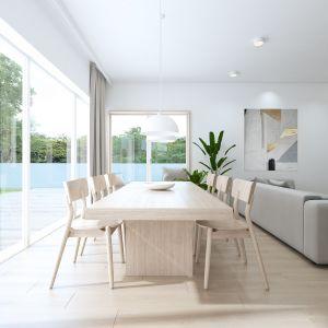 Otwarta jadalnia z ośmioosobowym stołem. Projekt: Sebastian Marach, pracownia Yono Architecture