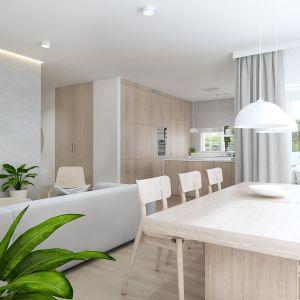 Część dzienną tworzą: salon, jadalnia oraz otwarta kuchnia. Projekt: Sebastian Marach, pracownia Yono Architecture