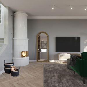 Tradycyjny piec wpisuje się w loftowy charakter wnętrza. Projekt Marcin Dekor x Loft Factory