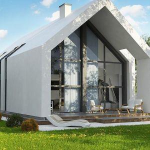 Klasyczną bryłę budynku, nawiązującą stylem do typowej stodoły, wzbogacają nowocześnie zaprojektowane detale. Nazwa projektu: Z215 A. Autorzy projektu: Studio Z500.