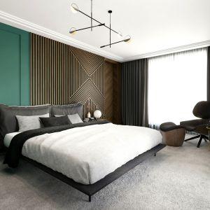 Ścianę za łóżkiem zdobią drewniane panele. Projekt Tissu Architecture