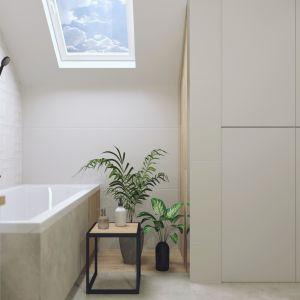 Jasną łazienkę na poddaszu zaprojektowano z wykorzystaniem białych płytek oraz drewna i betonu, zawiera ona także akcenty w kolorze czerni. Projekt i zdjęcia: Ewa Gil Cer