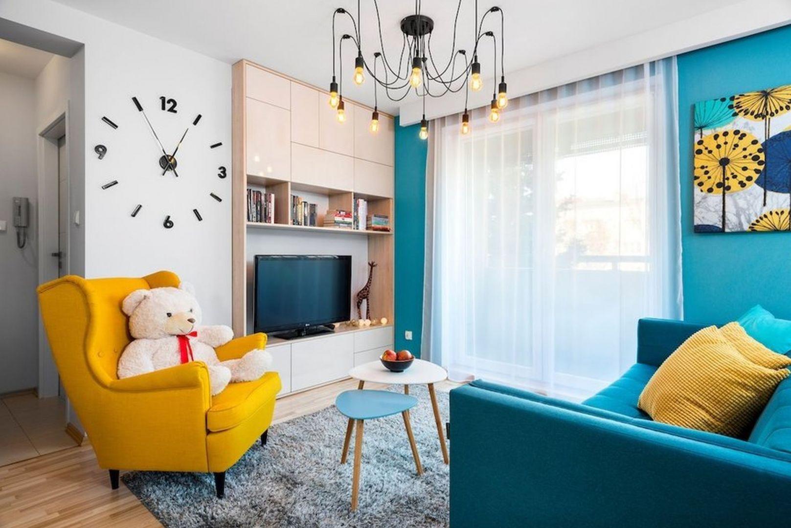 Żółty fotel uszak - król jesiennych aranżacji. Autorka projektu: Krystyna Dziewanowska, pracownia Red Cube Design. Zdjęcia Mateusz Torbus 7TH IDEA