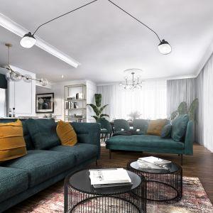 Kolorowy zestaw wypoczynkowy to świetny pomysł w salonie, gdzie mamy białe ściany i drewnianą podłogę. Projekt: Marta Ogrodowczyk-Trepczyńska, Marta Piórkowska, Oktawia Rusin. Wizualizacje: Elżbieta Paćkowska