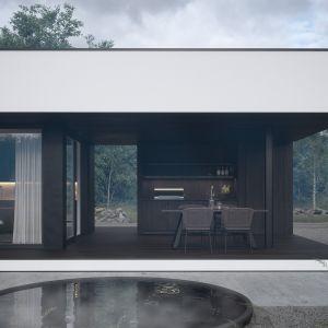 Letnia kuchnia wkomponowana w przestrzeń budynku to ciekawa propozycja dla mieszkańców i gości na urządzanie kolacji grillowych pod dachem. Projekt: pracownia HomeKONCEPT